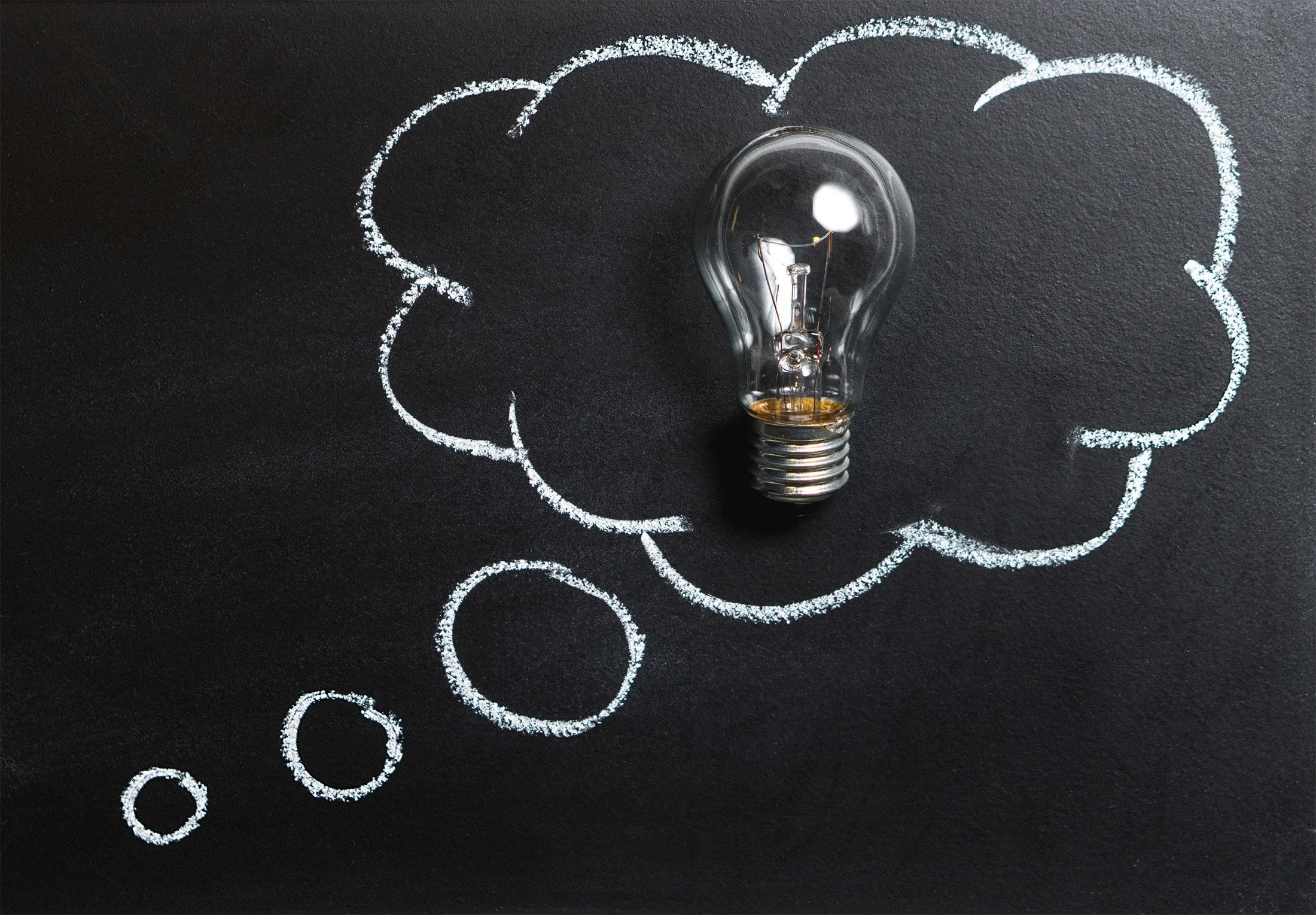 blackboard with light bulb